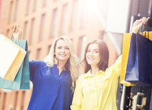Pretty women with shopping bags outdoors Stock Photography