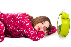 Pretty women sleeping with the alarm Royalty Free Stock Photo