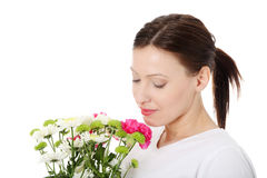 Pretty women smelling her garland of flowers Royalty Free Stock Image