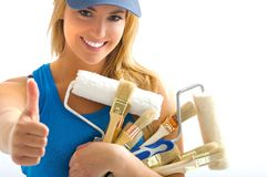 Pretty women and  tools. Pretty women and painting tools smiling Royalty Free Stock Photography