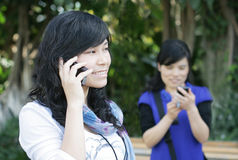 Pretty women using cell phones Stock Photo