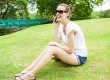 Young woman on smart phone in park Royalty Free Stock Photography