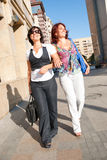 Pretty women walking. Down the street Stock Photography