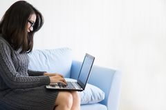 Pretty women working at home. Small business concept. Pretty woman using laptop for work at home. Small or start business concept stock photography