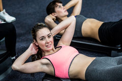 Pretty women working their abs Royalty Free Stock Image