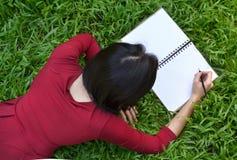 Pretty Women Writing Book Stock Image