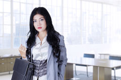 Pretty worker with briefcase at workplace Stock Photo