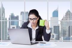 Pretty worker enjoy coffee in office Stock Photos