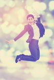Pretty worker jumping with blur background Stock Photo