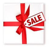 Pretty Wrapped Holiday Gift With Decorated SALE Tag Royalty Free Stock Image