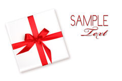Pretty Wrapped Holiday Gift With Red Ribbon and Bo Royalty Free Stock Photography