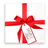 Pretty Wrapped Holiday Gift With Red Ribbon and Gi Stock Photos