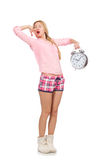 The pretty yawning girl holding alarm-clock isolated on white Royalty Free Stock Photo
