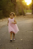 Pretty 3 1/2 year old Asian-Caucasian girl in pink dress Royalty Free Stock Photography