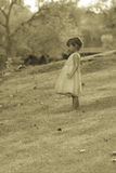 Pretty 3 1/2 year old Asian-Caucasian girl standing on grass Stock Images