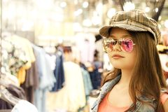 Pretty 12 year old girl blonde with long hair  in a shopping center for shopping stock photography
