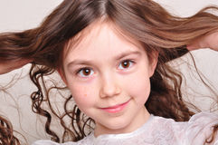 Pretty 8 year old girl in white dress stock photos