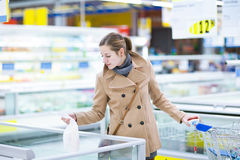 Pretty youman buying groceries in a supermarket Stock Photo