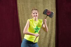 Pretty actress poses with axe Royalty Free Stock Image