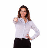 Pretty young adult in blouse pointing at you Royalty Free Stock Images