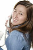 Pretty young adult on the phone Stock Photo