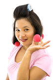Woman with hair curlers Stock Photos