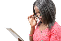 Pretty young african american woman with eyeglasses and tablet c Stock Photography