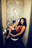 Pretty young african american woman in luxury restroom with mone Royalty Free Stock Images