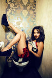 Pretty young african american woman in luxury restroom with mone. Y, like prostitute, dirty cash concept Stock Image