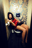 Pretty young african american woman in luxury restroom with mone. Y, like prostitute, dirty cash concept Stock Images