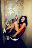 Pretty young african american woman in luxury restroom with mone. Y, like prostitute, dirty cash concept Royalty Free Stock Images