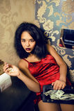 Pretty young african american woman in luxury restroom with money, like prostitute Stock Images