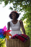 Pretty young african american woman riding a bike in forest Stock Images