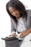 Pretty young african american woman with a tablet somputer Stock Images