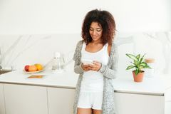 Pretty young afro american woman using mobile phone Stock Images