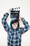 Pretty young alternative teen woman with movie clapper Stock Image