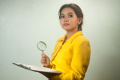 Pretty young Asian business woman looking document Stock Photography