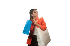 Young Asian business woman with shopping bags isolated on white background. Royalty Free Stock Images