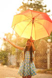 Pretty young asian girl in the rain. With umbrella Stock Photos