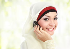 Asian Muslim woman calling Stock Images