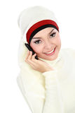 Asian Muslim woman talking on the phone Stock Photos