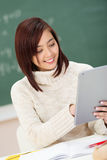 Pretty young Asian student using a tablet-pc Royalty Free Stock Photo