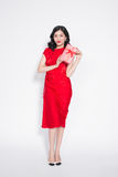 Pretty young asian woman dressed in red dress with a present Royalty Free Stock Images