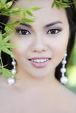 Pretty Young Asian Woman in the Park Royalty Free Stock Photography