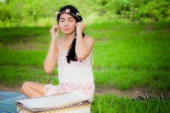Young asian woman picnic on the meadow stock images
