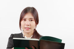 Pretty young Asian woman  reading a book with considerate and thoughtful posture. Stock Image