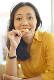 Pretty Young Attractive Woman Eating Donut  At Cafe Stock Images