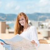 Pretty young au-pair studying a map Royalty Free Stock Photography