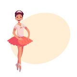 Pretty young ballerina in pink tutu standing on toes Royalty Free Stock Images