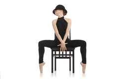 Pretty young ballerina sitting on the chair Royalty Free Stock Photo
